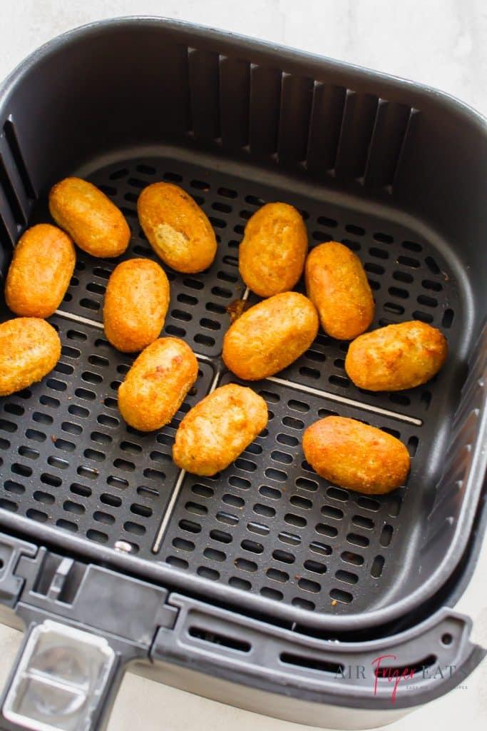 Mini corndogs in an air fryer basket