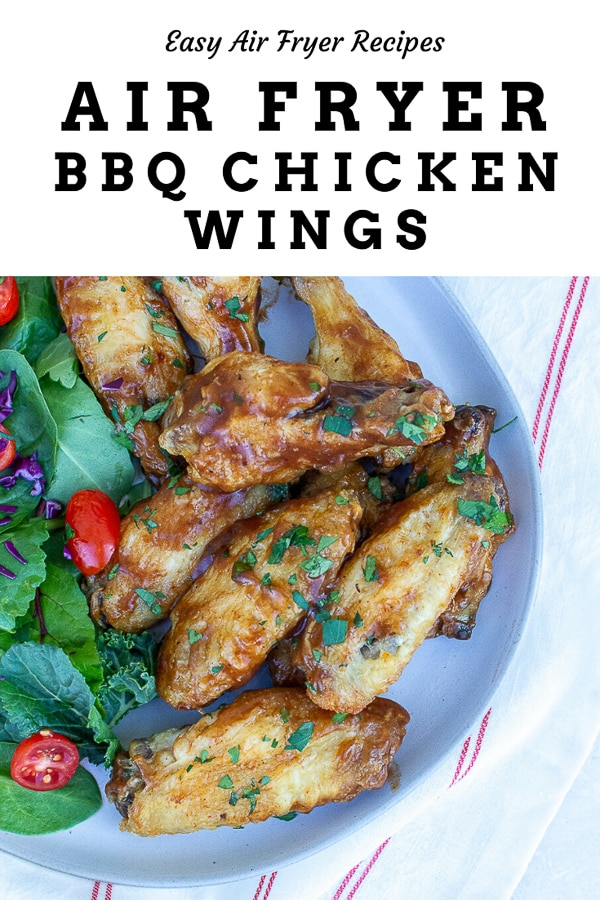 Air Fryer BBQ Chicken Wings are a delicious and savory appetizer that you'll love! Brush these crispy wings with your favorite BBQ sauce for a combination that'll leave your taste buds begging for more! #chickenwings #bbqwings #airfryer #airfryerchickenwings #barbecuewings