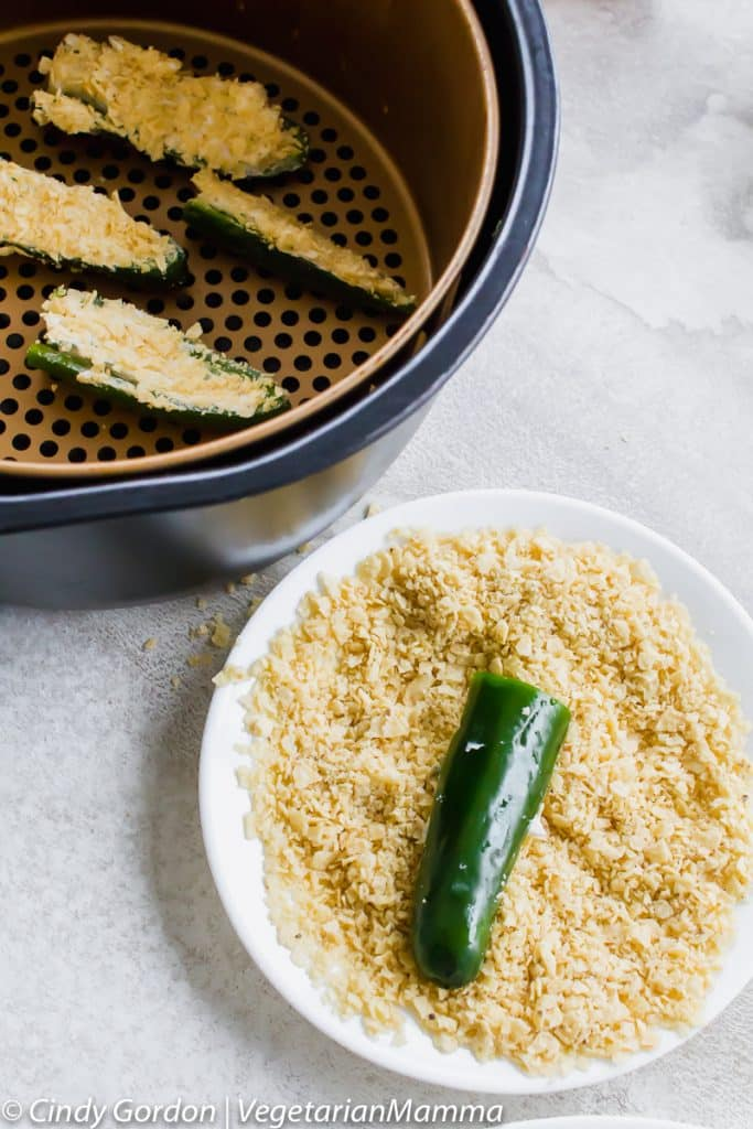 These Air Fryer Jalapeno Poppers are pretty amazing. They are a spicy, mouth watering, naturally gluten-free snack! We also offer up traditional oven instructions too!