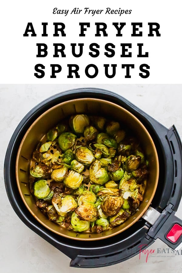 browned air fryer brussels sprouts in a round air fryer basket