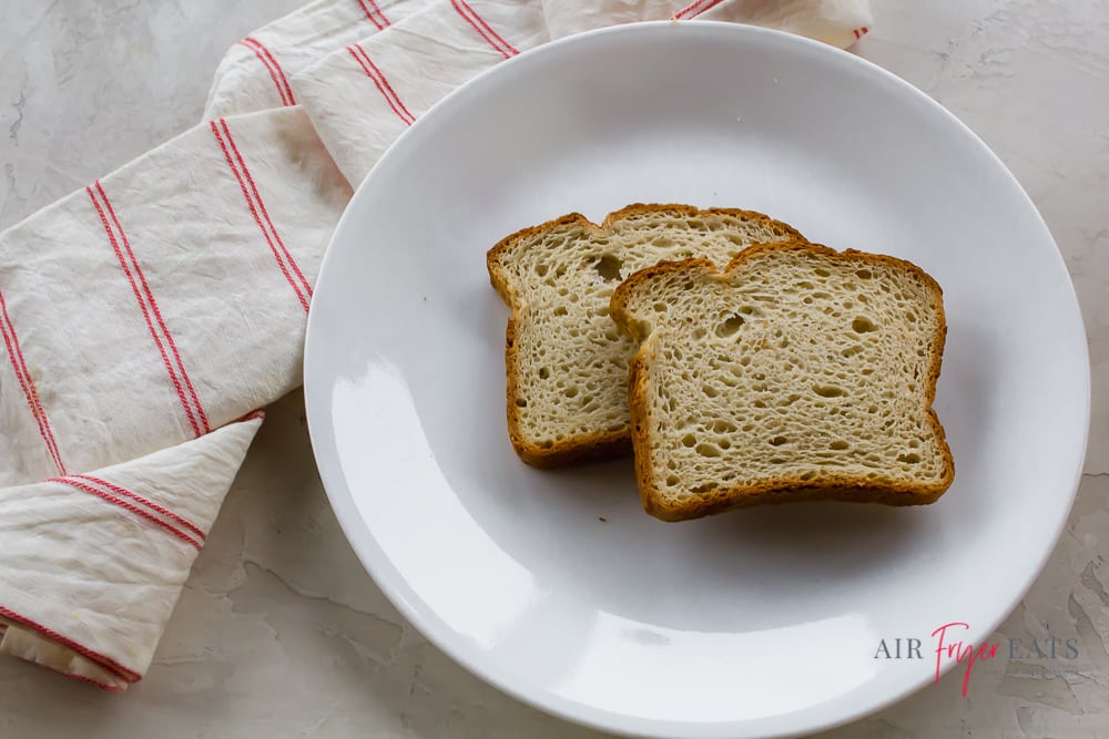two slices of bread on a round white plate