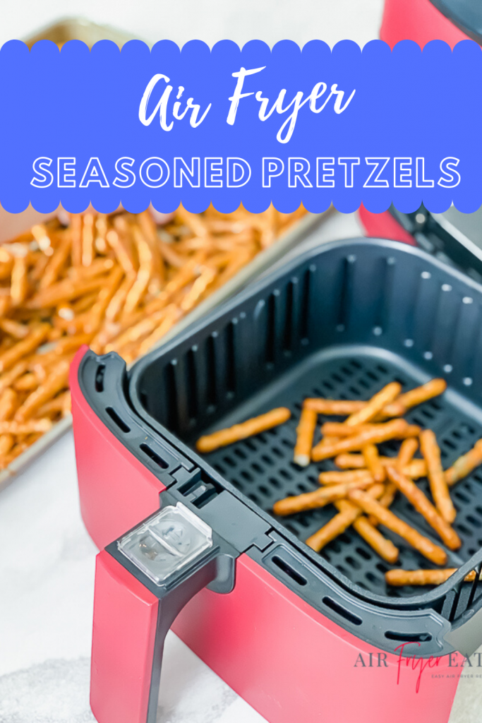 vertical image of red air fryer basket with pretzels inside and pretzels in a lipped baking sheet in the top left. Text overlay says Air Fryer Seasoned Pretzels