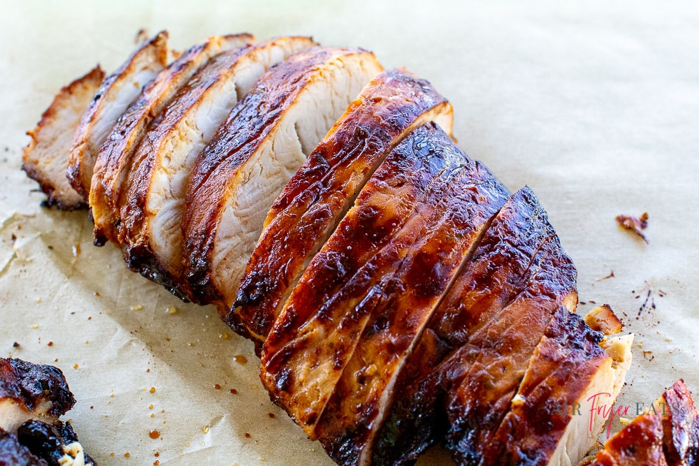 sliced seasoned turkey breast on parchment paper