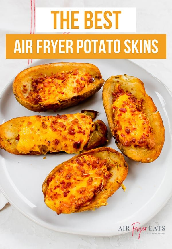"""the best air fryer potato skins"" text is overlaid on top of a picture of cooked potato skins on a white plate."