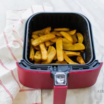 steak fries in red and black air fryer basket