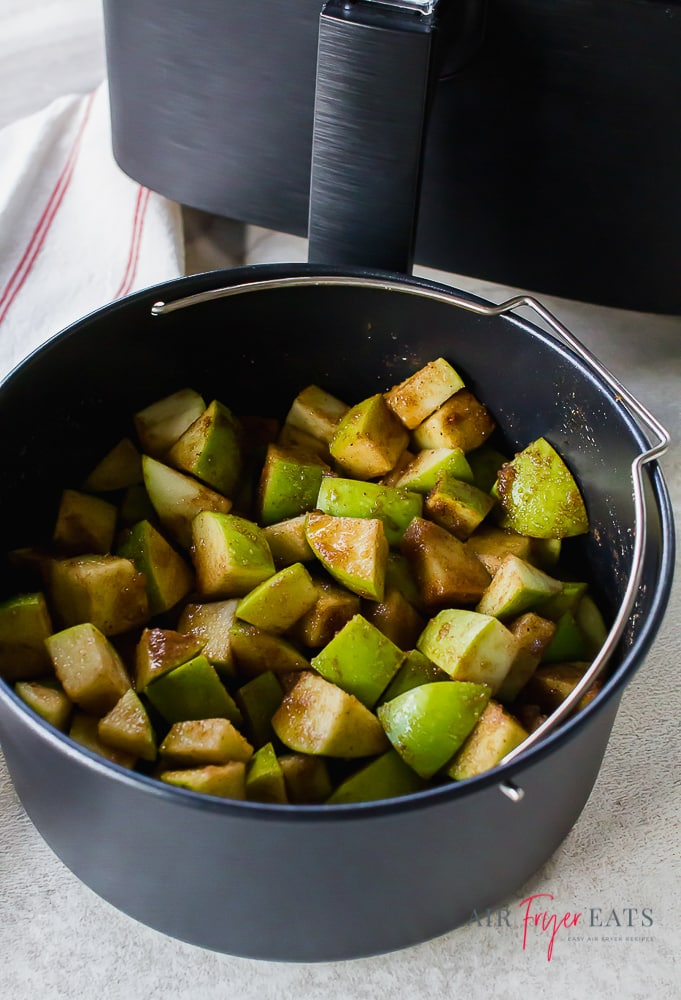 cooked Granny Smith apples covered in seasonings and sugar