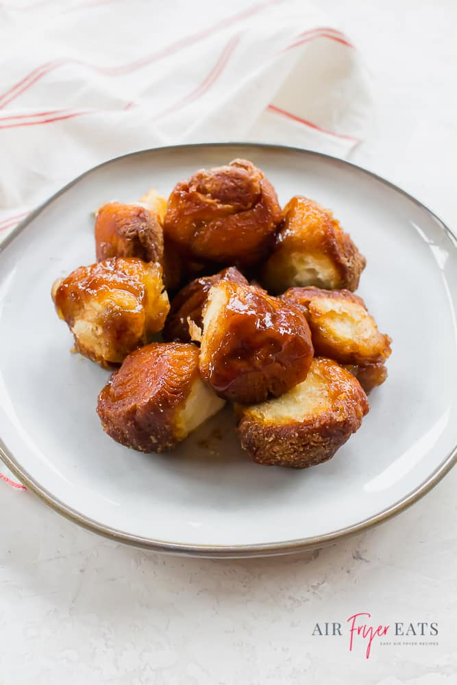 a white plate with pieces of air fryer monkey bread
