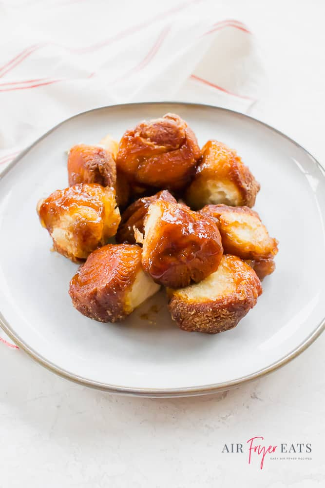 Pieces of monkey bread on a white plate