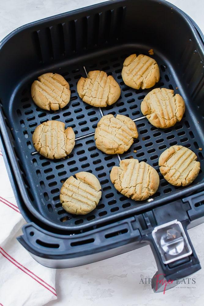 Nine cookies baked in an air fryer basket