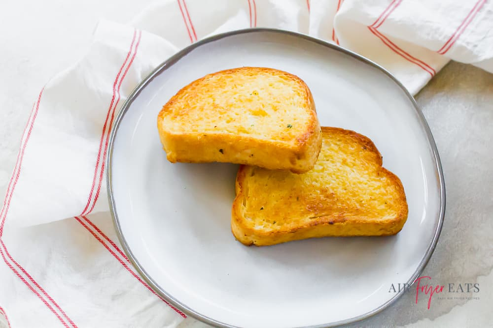 two slices of texas toast on a white plate