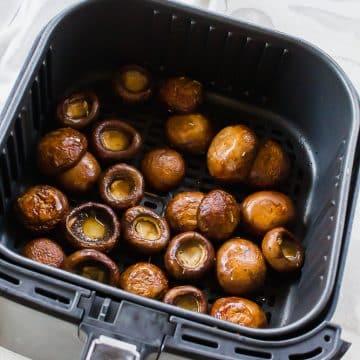 cooked mushroom caps in air fryer basket