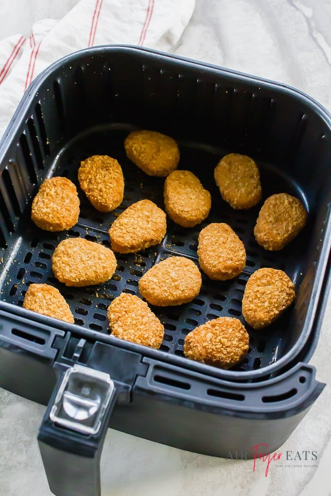 chicken nuggets in black air fryer basket