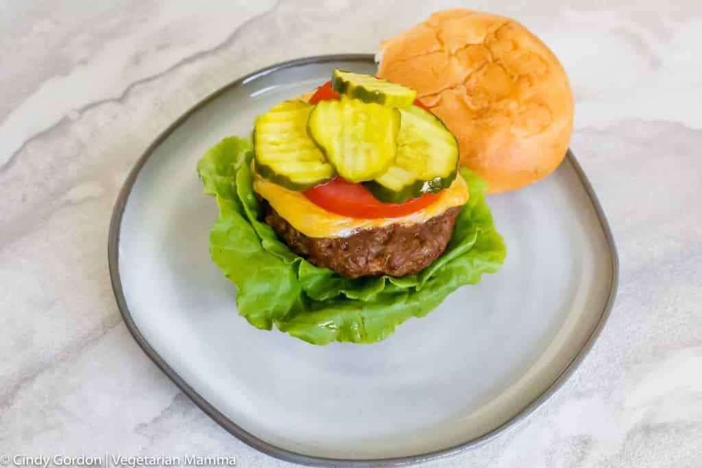 air fryer hamburger with lettuce cheese tomato pickle and bun