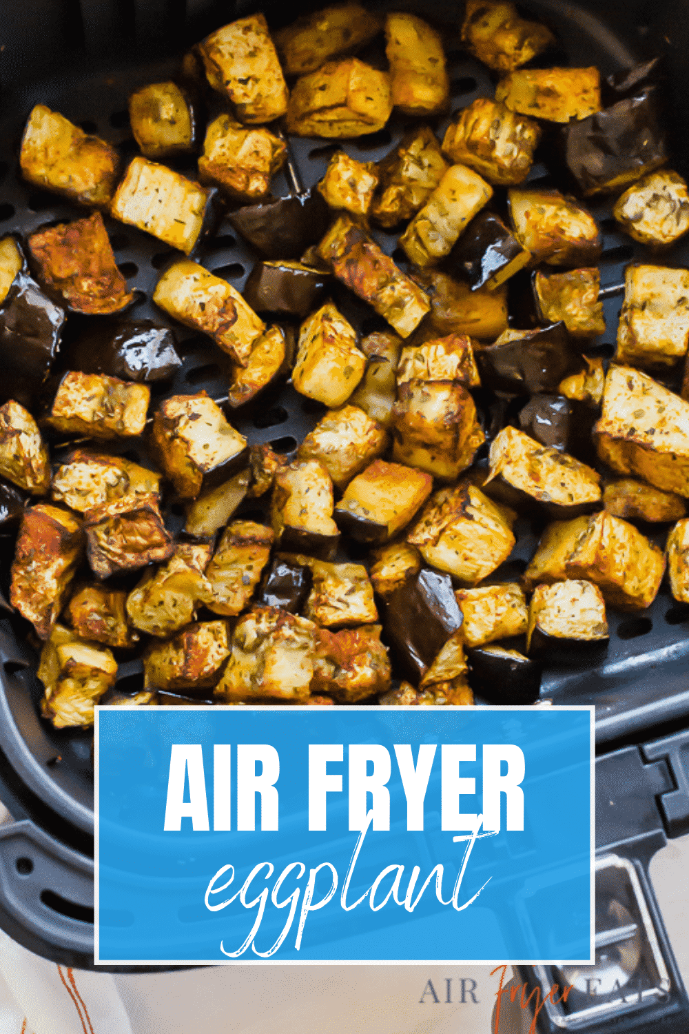 air fryer eggplant text over a black air fryer basket with eggplant inside