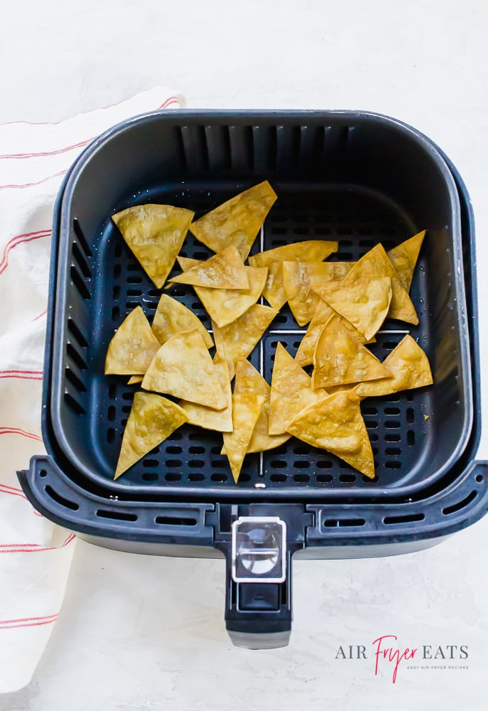 air fryer tortilla chips in black air fryer basket