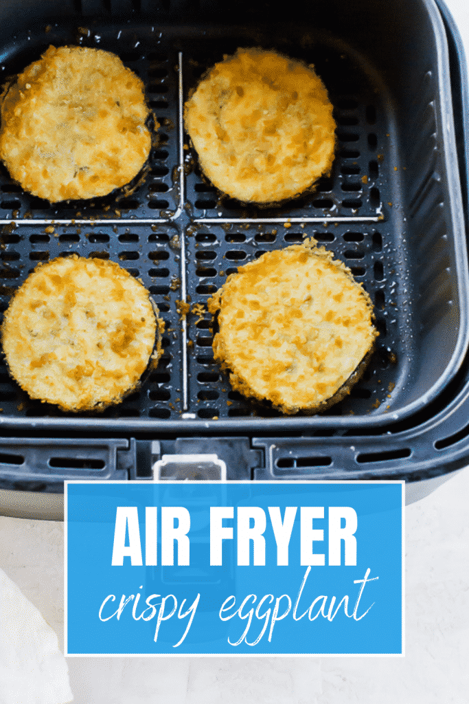 """4 coated eggplant circles in a black air fryer basket with the words """"air fryer crispy eggplant"""