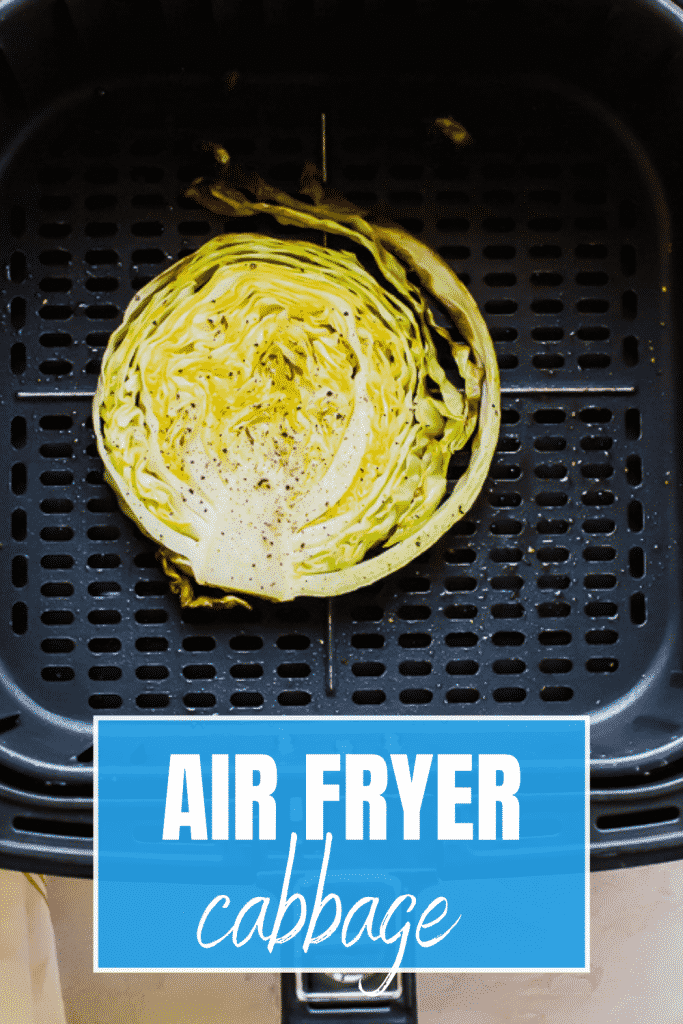 air fryer basket with a browned cabbage steak inside.