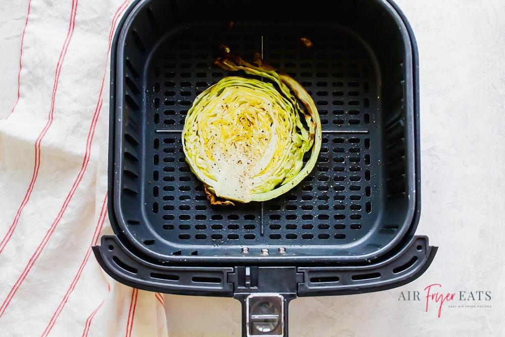 cabbage steak inside of a square air fryer basket
