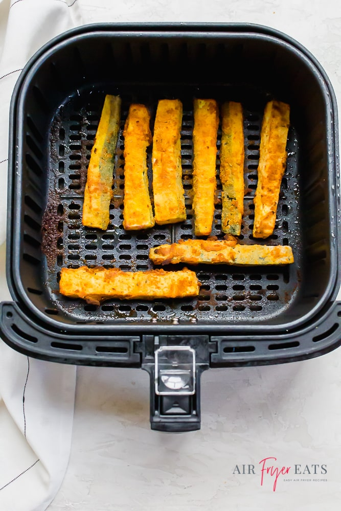 Zucchini fries in a square air fryer basket
