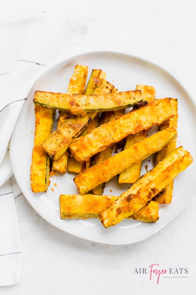 a round white plate of zucchini fries