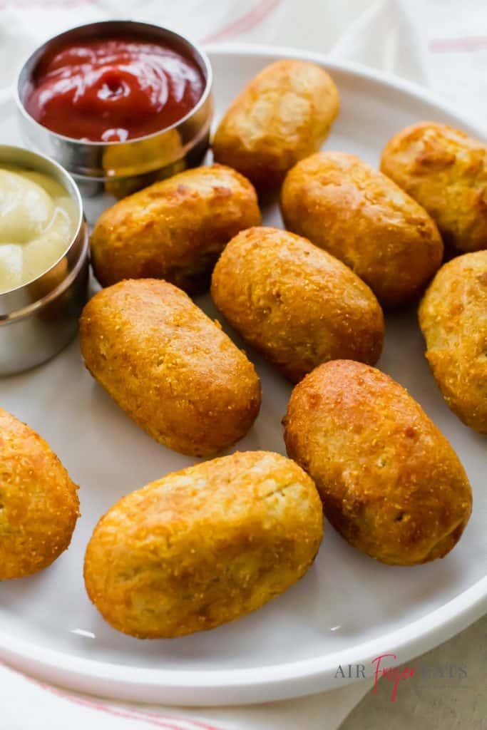 golden brown mini corn dogs on a white plate