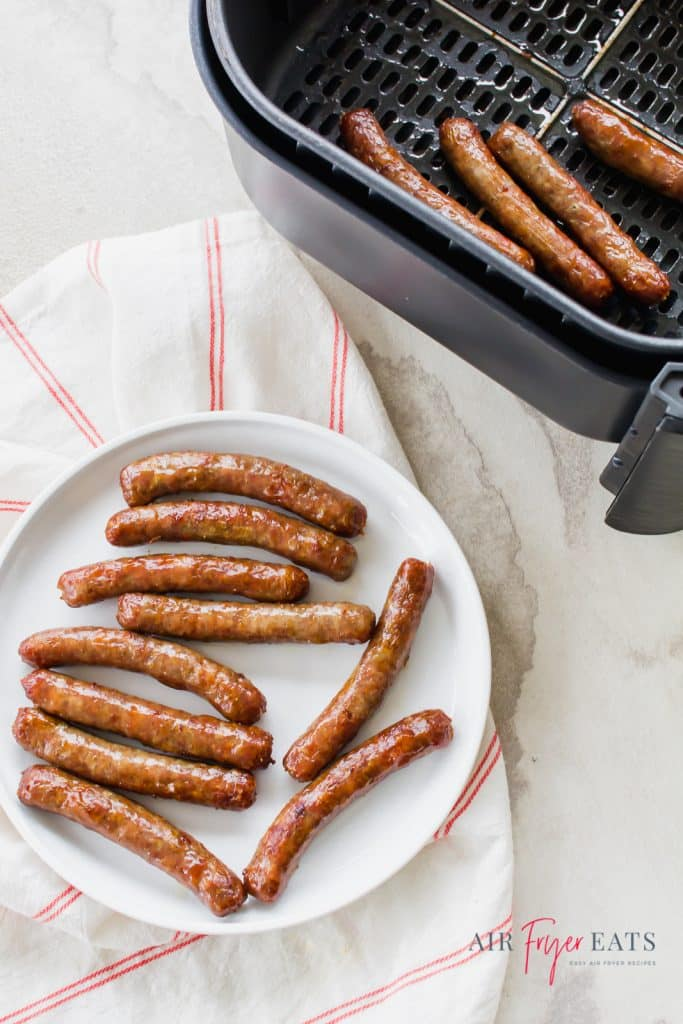 air fryer sausage links, cooked from frozen sausage links in a black air fryer basket at the top right of the vertical photos and some on a white plate on the bottom of the photo.