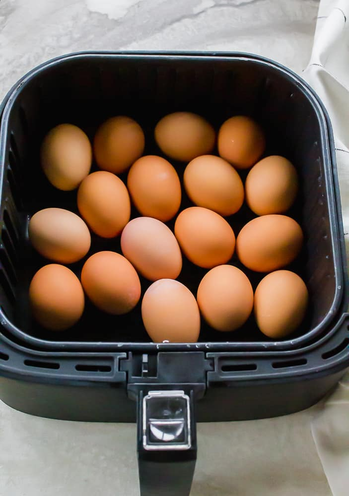 a square air fryer basket full of brown eggs