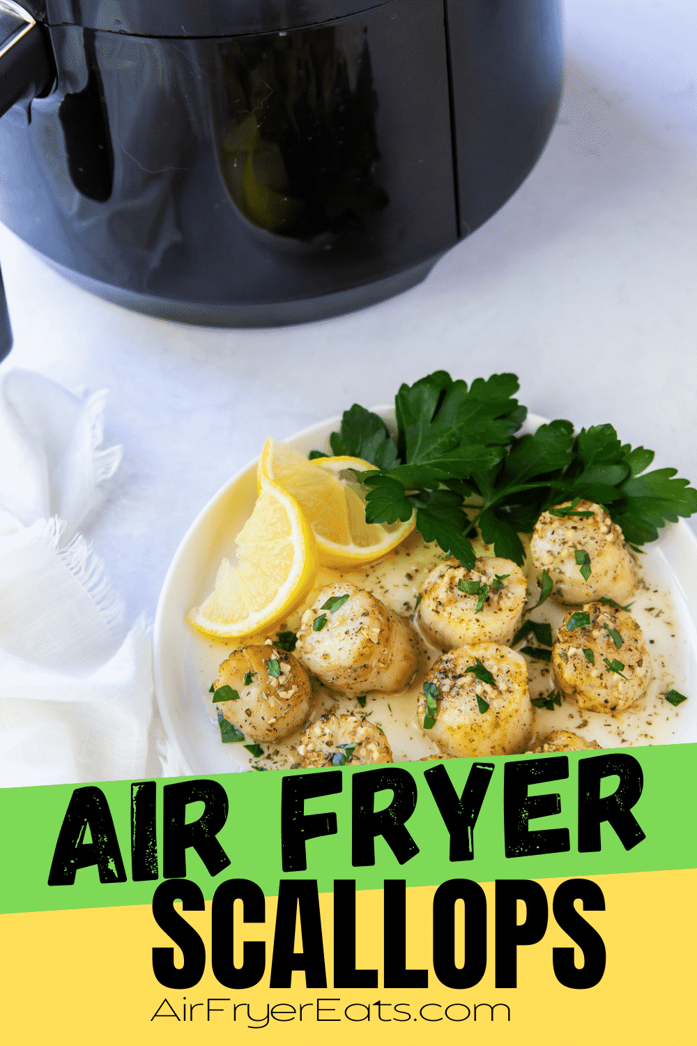 Scallops are not just for eating in a fancy restaurant anymore! Learn to make delicious and perfectly cooked Air Fryer Scallops with a garlic and herb butter sauce that will rival any seafood chef's best dish. #seafood #airfryer #scallops via @vegetarianmamma