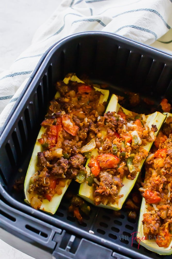Zucchini halves stuffed with meat in side an air fryer basket