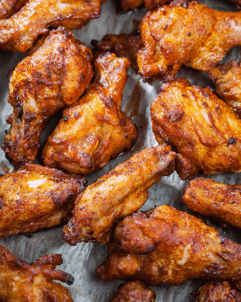 Close-up shot of cooked chicken wings seasoned with a red dry rub