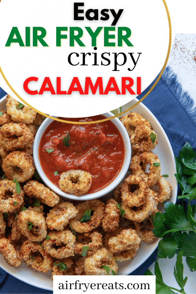 a large plate of calamari rings and a cup of marina sauce in the center. Title on image states, Easy Air Fryer Crispy Calamari