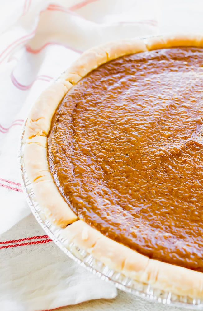 an image of half of a pumpkin pie on top of a red and white striped towel