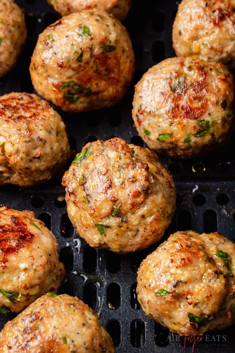 Turkey meatballs inside an air fryer basket