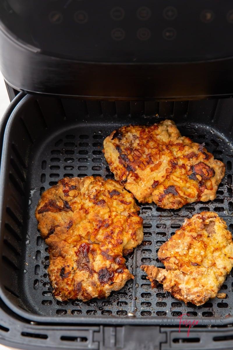 crispy fried cube steaks in an air fryer basket