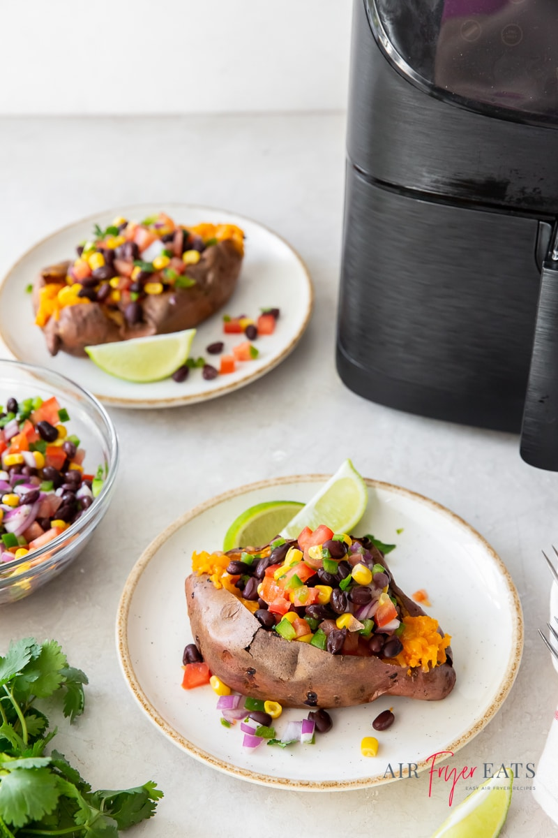 Three plates of mexican sweet potatoes surrounding an air fryer