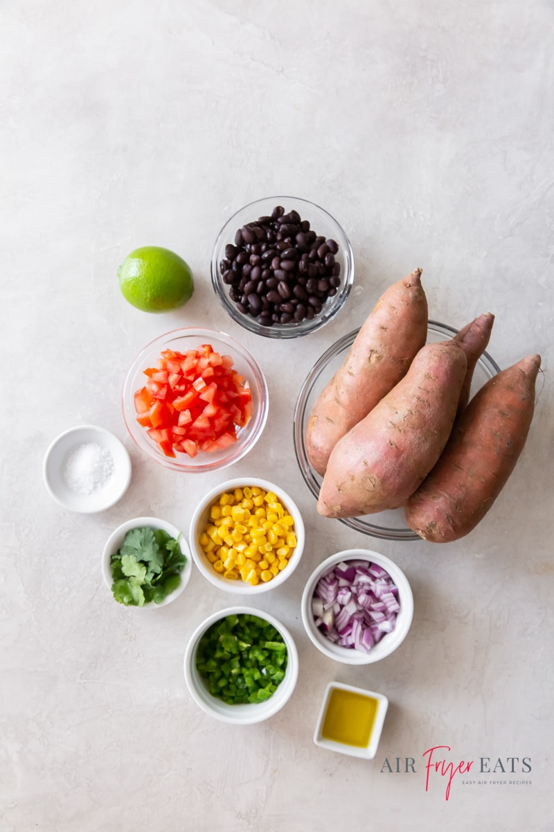 ingredients for air fryer mexican sweet potatoes with salsa, each in separate bowls on a countertop